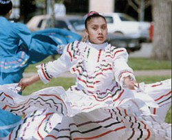 Graciela Santiago performs at the Mexican Fiesta in Finney County