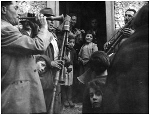 Musicians playing in the street, Caffiano, Campania, 1955